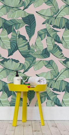 Bring some tropical fun into your home with this leaf print wallpaper. Illustrated banana leaves are set against a dusty pink, giving a gentle but cheerful contrast. This wallpaper design brings charm and character to bathroom spaces.