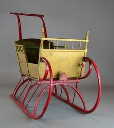 "A VICTORIAN BENTWOOD & IRON MOUNTED SLEIGH  	      	                  A child's sleigh in bentwood, with iron runners, and bracing, painted gold and red, with green tufted velvet seat, 56"" L x 37"" H x 16.5"" W, circa late 19th early 20th century. Condition: slight paint loss in areas, otherwise very good condition. Private collection Metamora, Mi."