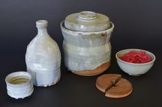 Hand-Thrown, Ceramic, Water-Seal Fermenting Crocks by Hadar Iron. These beautiful hand-made crocks, make home-made sauerkraut and diy pickling easy and fun.