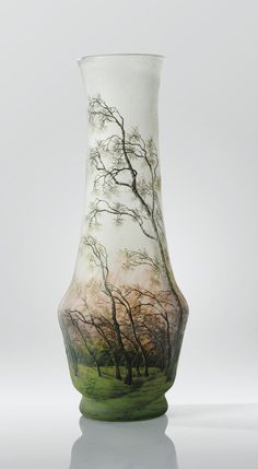 A CAMEO GLASS, INTERNALLY DECORATED, ACID-ETCHED AND ENAMELLED GLASS VASE BY DAUM, CIRCA 1895-1900. SIGNED AND WITH CROSS OF LORRAINE