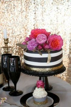 Kate Spade inspired bridal shower -- striped cake topped with flowers