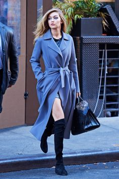 There's nothing like a flash of leg in winter and Hadid is single-handedly ensuring us that all we *really* need to be chic this winter is a sumptuous robe coat and over-the-knee suede boots.     - MarieClaire.com