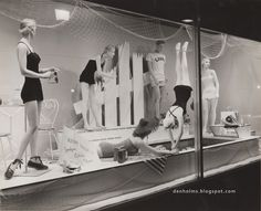 The Denholms Blog window display from July 1954 to highlight ladies swimsuits.
