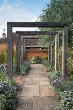An oak pergola, weathered to an attractive silver gray, marks the entrance to th. - An oak pergola, weathered to an attractive silver gray, marks the entrance to th… An oak pergol - Garden Arbor, Diy Garden, Garden Cottage, Dream Garden, Garden Paths, Walkway Garden, Garden Structures, Front Garden Entrance, Garden Archway
