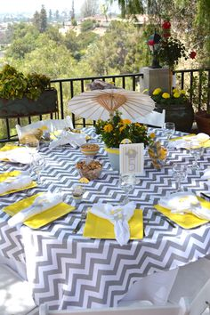 A Modern Chic Elephant Baby Shower with elephant, umbrella floral centerpieces, chevron overlay and custom made elephant napkin rings.