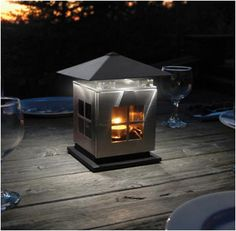 Outdoor lighting with the JOI outdoor lamp by Thermologic. The JOI patio lamp uses patented thermoelectric technology to light up 8 bight LED bulbs giving users the ability to light their patio wirelessly. Led Lantern, Lanterns, Home Lighting, Outdoor Lighting, Lighting Ideas, Carpenter Bee Trap, Candle Power, Can Lights, Power Led