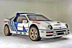 GGGAAAHHH why have I never seen a custom replica of one of these! Ford Group B rally car Mid-engined all-wheel-drive awesomeness Ford 2000, Ford Rs, Car Ford, Sport Cars, Race Cars, Carros Suv, Ford Motorsport, Automobile, Old American Cars
