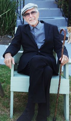 Leonard Cohen with walking stick cane