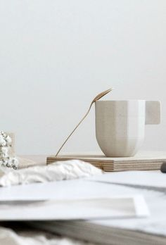 Soft colours - Hay like paper cup and gold tea spoon from Zara