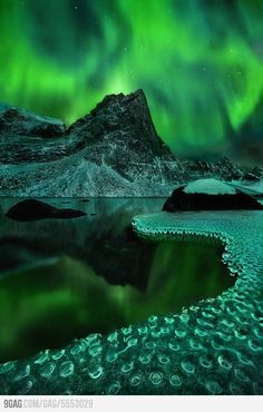 Magical view of Aurora Borealis reflected on frozen icicles.