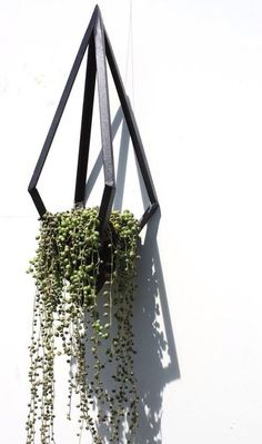 Urban and contemporary black steel diamond shaped hanging basket/planter, hand-made by artist Daniela Rubino. 50 x 20 cm - £75 from www.anartfullife.co.uk.  plant, houseplant, planter, string of pearls, succulent, hanging planter, geometric,