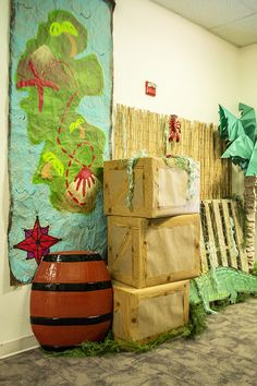 Wrap cardboard boxes in brown roll paper for a fun island feel. Add a barrel and pallets! Children's Church Crafts, Vbs Crafts, Treasure Island Game, Deco Pirate, Island Crafts, Pirate Island, Library Themes, Vbs Themes, Island Theme
