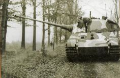 Tiger II tank resting on the side of a road