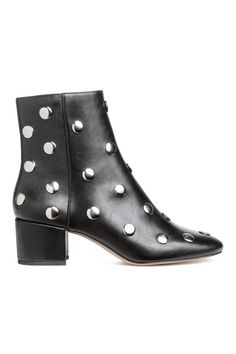 Check this out! Ankle boots in faux leather with round metal studs. Slightly higher leg section, zip at one side, and covered block heels. Fabric lining, faux leather insoles, and rubber soles. Heel height 2 1/4 in. - Visit hm.com to see more.