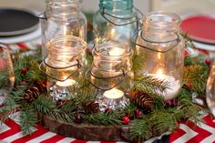 Christmas Centerpiece: Use a piece of wood for the base, then add greenery with cranberries, pine cones, and candles.
