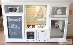 This is adorable!!! Repurposed Entertainment Center Turned Play Kitchen