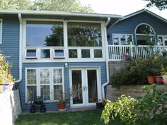 Look how nice this two-story home with blue siding looks with the white trim touches.  Many homeowners in Minneapolis and St. Paul are choosing to have us install steel siding on their homes.  http://www.quarve.com/