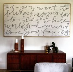 "This artwork by The House of Belonging in Rebekah Lyons' home gives us all the holiday feels, ""If you want to bring happiness to the whole world, go home and love your family."""