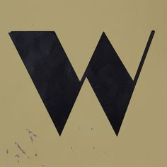 random, cool font. looks like the Great Gatsby or a superhero in the 60s.  |  letter W by Leo Reynolds, via Flickr