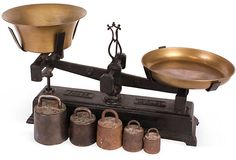 Large 10-kilo general-store scale with brass trays and weights, 1880s. Made by Force.