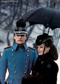 I LOVE her hairstyle and her hat! Romy Schneider and Helmut Berger, Ludwig 1972.
