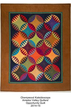 """Cherrywood Kaleidescope"", opportunity quilt, Amador Valley Quilters. Rattlesnake design by Karen Stone. The feeling is almost Amish."