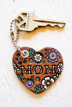 Hand-painted and stamped Mom keychain for a Mother's Day gift. Stained in a chocolate brown with a full array of intricately hand-painted accent colors for a wonderful unique present for your mamma. Flowers For Mom, Piel Natural, Leather Key, Custom Leather, Unique Presents, Unique Gifts, Leather Earrings, Teardrop Earrings, Gifts For Her