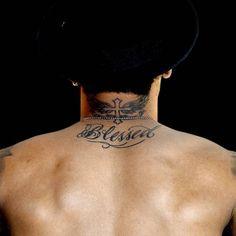 Neymar Blessed tattoo on Neymars upper back and winged...