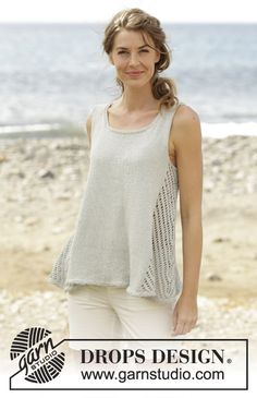 "Knitted DROPS top with lace pattern in the sides and A-shape, worked top down in ""Belle"". Free Pattern"