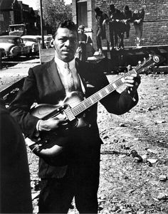 Little Walter on Maxwell Street Playing Guitar – 1964 (Photo by Ray Flerlage)