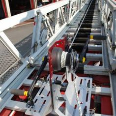 Innovative kit that allows the use of the winch ORTLES on a motor ladder, for the rescue, the recovery and the transport of people in hardly reachable positions