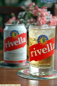 Rivella is a soft drink from Switzerland, created by Robert Barth in 1952, which is produced from milk whey, and therefore includes ingredients such as lactose, lactic acid and minerals. It comes in four varieties:  Red Rivella, the original version.  Blue Rivella, a low calorie version of Red Rivella.  Green Rivella, which is flavoured with green tea extract.  Yellow Rivella, which is made with soy rather than dairy milk extracts.
