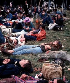 View of hippies and teenagers relaxing whilst sitting and lying on grass at a 'Love-In' at the Festival of the Flower Children in the grounds of the Duke of Bedford's Woburn Abbey estate in Bedfordshire during the 'Summer of Love' in England in August 1967. (Photo by Rolls Press/Popperfoto/Getty Images