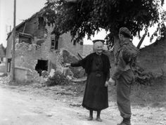 Canadian soldier of the Régiment de la Chaudière, asks for directions from an elderly French civilian.