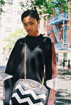 Selah Marley in a vintage panelled sweater and Gucci GG Marmont chevron tote bag
