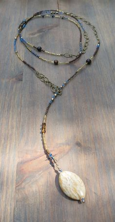 Lariat in mustard yellow, cornflower blue & bronze with Miyuki seedbeads, wooden beads, crystals, bronze chain, vintage beads & wire wrapped stone pendant. *Each lariat comes with our clip bead