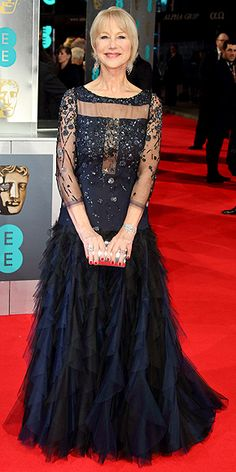 BAFTA Fashion: See What the Stars Wore | HELEN MIRREN | It's a major night for Helen (Prince William is presenting her with an award), so she wears a major dress: an embellished black gown with sheer sleeves and décolletage, beading on the bodice and a tulle-heavy skirt.