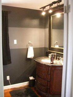 I had this idea, my inspiration, went from here. Black and Gray Horizontal Wall Stripes: When I went and finally got around to painting the guest bathroom, I really wanted to try something that I've been seeing on television shows. I know