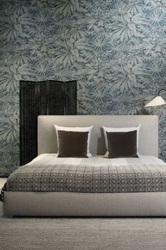 Beautiful palm leaves wallpaper design printed on a faux-grasscloth texture.