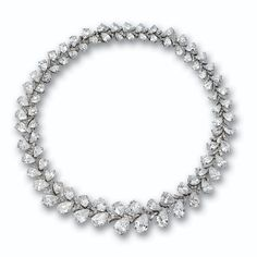 DIAMOND NECKLACE-BRACELET COMBINATION, HARRY WINSTON. Of foliate design, set with 84 pear-shaped diamonds weighing approximately 81.00 carats, arranged in pairs in a flexible, graduating strand, spaced by 246 baguette diamonds weighing a total of approximately 7.50 carats, mounted in platinum, length 15¼ inches, detachable in several places to shorten or form a bracelet, unsigned. With envelope signed Harry Winston.