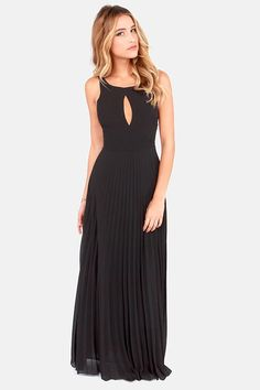 I am in need of a black dress I was told.  I think I like this one.  Accordion Player Backless Black Maxi Dress at LuLus.com!