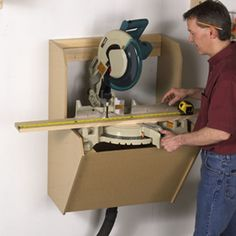 "Woodworking Shop On-the-Wall Mitersaw Station Woodworking Plan from WOOD Magazine - Made of only and '"" MDF, this wall-hugging unit not only preserves floor space (it's just deep), it also contains the blast of sawdust from a notoriously messy tool. Learn Woodworking, Woodworking Patterns, Popular Woodworking, Woodworking Crafts, Woodworking Plans, Woodworking Techniques, Woodworking Basics, Sauder Woodworking, Woodworking Jigsaw"