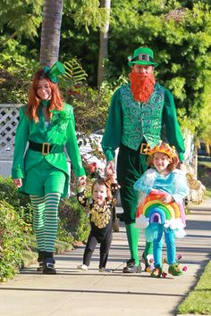 Alyson Hannigan  Alexis Denisof's Trick-Or-Treat Fun with their daughters Satyana and Keeva. With all that red hair in the family, they became a family of leprechauns this year, including the Pot Of Gold!