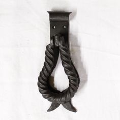 A blacksmith made rope twist wrought iron door knocker. Surface mounted, fixes to the door with 4 round head, black Japanned screws, no need to drill holes right through the door. £45.00