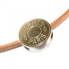 HERMES, collier cuir naturel et clou de selle coulissant