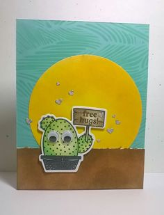 Valentine's day card I created for my son's principal.  Cactus offering free hugs. Distress ink used for background,  sun and ground.