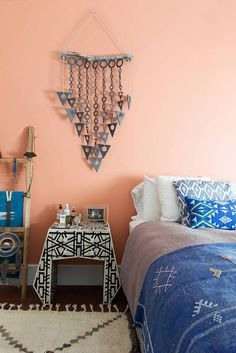 """Jessica Hendricks Yee chose a shade inspired by the desert and her Palm Springs wedding for her bedroom walls to make the room feel """"soft and serene"""". Paired with tribal-printed accessories, the whole space is a calming oasis. Coral Bedroom Decor, Calming Bedroom Colors, Bedroom Wall Colors, Bedroom Color Schemes, Colour Schemes, Peach Rooms, Peach Bedroom, Peach Walls, Palm Springs"""