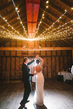 Daddy daughter dance  Credits: Dress by Kathryn Conover, Photography: Divine Light Photography - dlweddings.com @Divine Light Photography; Venue: Rufflands Farm, Red Hook, NY - Formal Barn Wedding + Cascading string lighting