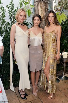 Glistening: Alessandra, as always, was absolutely radiant at the event wearing a striking gold sequinned dress. She is pictured here with fellow stars Amber Valletta and Emily Ratajkowski