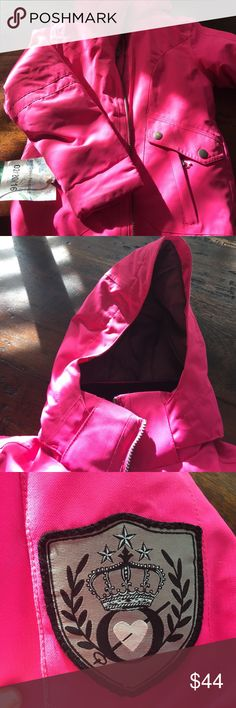 Girl's winter / ski coat Bright pink, girl's Obermeyer winter / ski coat.  Great ski coat or just wear on a snowy day!  In Great condition; no stains, tears, tips etc.  zips up the front.  Two side pockets on the front. Velcro on the end of sleeves so you can tighten around gloves.  Warm hood that is detachable.  Powder skirt inside, pocket inside!  Obermeyer, girl's Size S, size 8.  $48. MINT condition.  One small black spot on back of sleeve, I think will wash out. Obermeyer Jackets…